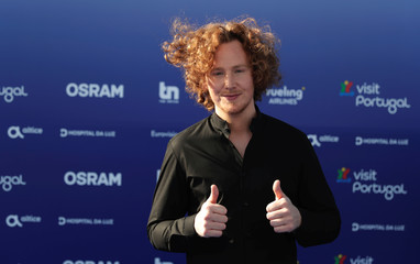 Contestant Michael Schulte of Germany poses on the blue carpet during the opening party for Eurovision Song Contest at the Maat museum in Lisbon