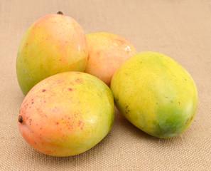 mangos on burlap background
