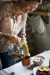 Woman serving hot coffee for breakfast