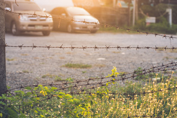 Barbed wire blocking the territory a parking.
