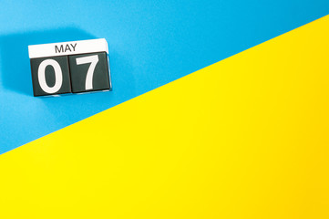 May 7th. Day 7 of may month, calendar on blue and yellow background flat lay, top view. Spring time. Empty space for text