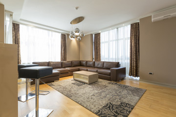 Interior of a modern open plan hotel apartment, living room