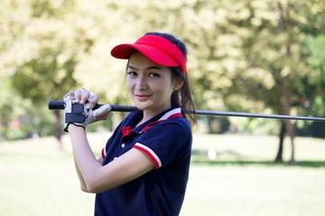 Lady golfer is playing golf