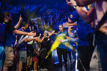 Members of the Boston Uprising team enter the arena before the first round of the semi-finals in the Stage 3 title matches of the Overwatch League at the Blizzard Arena in Burbank