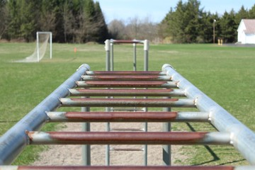 looking across two sets of monkey bars from over the top