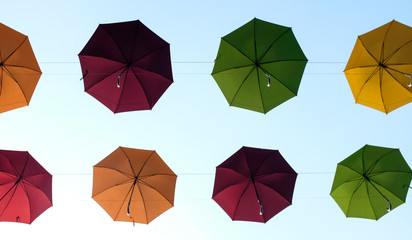 colorful umbrella with bring blue skies
