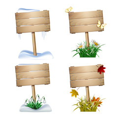 Set of wooden signs in four seasons.