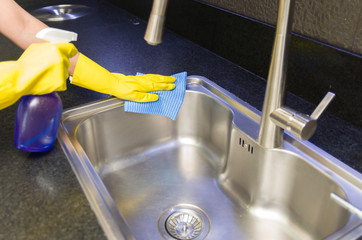 Great concept of domestic cleaning, woman cleaning the sink