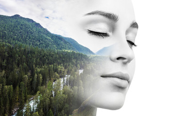 Young woman combined with photograph of nature.
