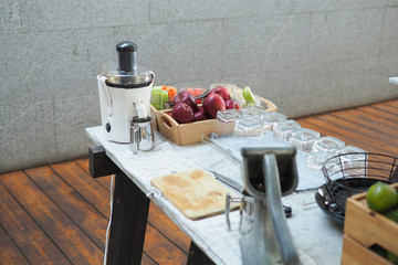 Fruits and blender machine in the kitchen