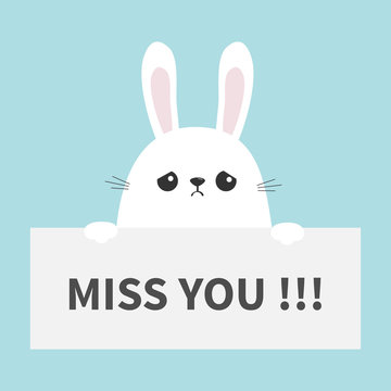 White sad bunny rabbit hanging on paper board Miss you. Funny head face. Big ears. Cute cartoon character. Kawaii animal. Easter symbol. Baby card. Pet collection. Flat design. Blue background