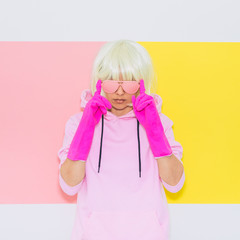 Blonde Girl Model with beauty face in Fashion accessory sunglasses, gloves,  hoodie and shorts. Club DJ Party Fun. Mood and vibes. Minimal unicorn style. Pink and yellow neon colors. 90s or 80s trend