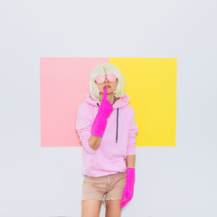Doll Blonde Girl Model with beauty face in Fashion accessory sunglasses takes off the gloves. Mood and vibes. Minimal unicorn style. Pink and yellow neon colors. 90s or 80s trend