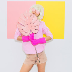 Tomboy Doll Blonde Girl in Fashion pink accessory sunglasses holds Palm Leaf. Club Party Style. Synth wave vibes