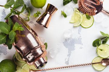 Mojito cocktail ingredients on white stone table