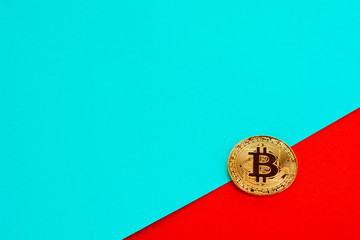 Bitcoin on colorful paper background with copy space