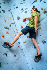 Teenage Boy Training On Climbing Wall