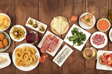 Spanish tapas food on dark background with place for text