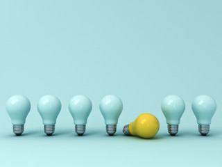 Think different concept , One yellow idea bulb lying down with the standing unlit light bulbs on blue pastel background with shadows , leadership and individuality creative concepts . 3D rendering.