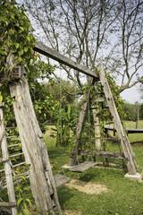 Outdoor wooden swing in field