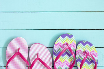 Colorful flip flops on blue wood planks.Summer Background