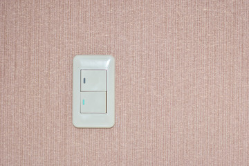 Light switch, electricity in the house on the wall