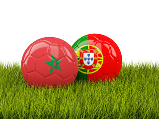 Morocco vs Portugal. Soccer concept. Footballs with flags on green grass