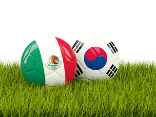 Mexico vs South Korea. Soccer concept. Footballs with flags on green grass