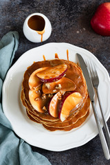 Apple Caramel Pancakes On White Plate. Homemade Tasty Pancakes. Apples With Caramel Sauce. Top View