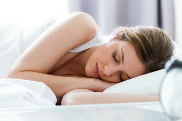 Beautiful young woman sleeping in the bedroom.