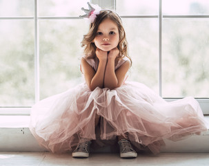 Little cute girl in dress