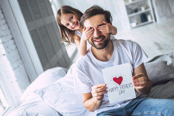 Dad with daughter at home