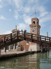 tourist on the bridge taking photo with their smart phone at the Arsenal Entrance in Venice