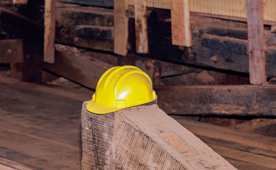 Worker helmet used for safety kept on a wooden plank at a saw mill factory at Andaman, India.