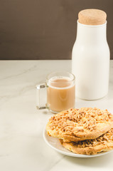 Coffee break with fresh dry biscuit with nuts and bottle milk/ Coffee break with fresh dry biscuit with nuts and bottle milk. Selective focus and copyspace