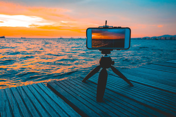 Photographing a sunset with a mobile phone