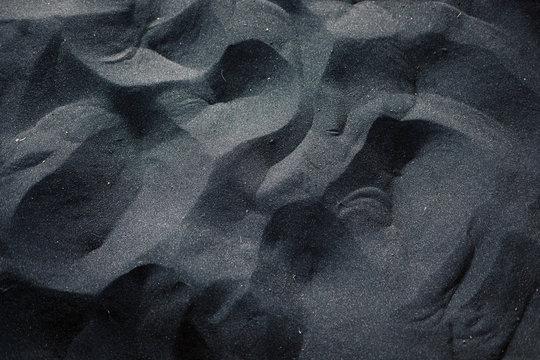 Black sand floor texture from above. Interior, exterior design ideas