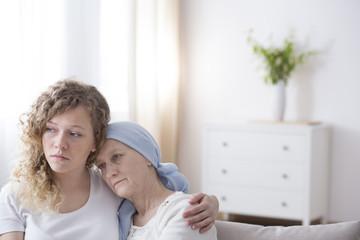 Sad girl and sick mom