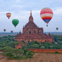 Ancient Sulamani pagoda and hot air balloons flying over Bagan, Mandalay Division, Myanmar