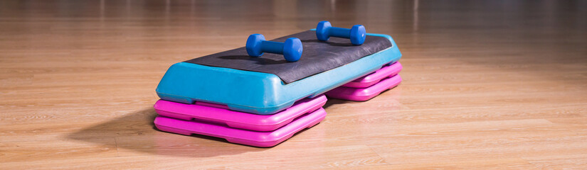Step platform in gym, equipment for effective exercises