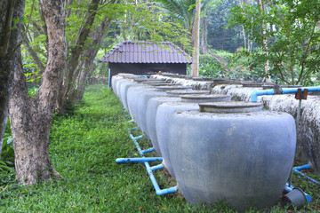Rows of water tanks as a water reserve for the future use at a time of drough or prolonged period of abnormally low rainfall.