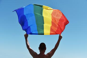 man with a rainbow flag over his head