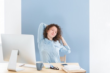 Overworked professional young female worker tired of sitting on one place, has fatigue expression release tension after long working hours in office