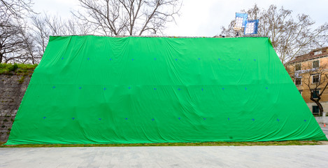 Giant green screen chroma key background on commercial set.
