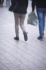 People walking sidewalk pavement