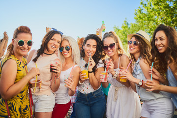Group of female friends dancing and having a good time at the outdoor party/music festival
