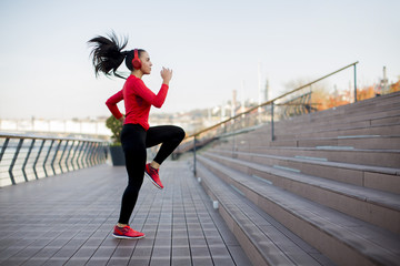 Fitness woman jumping outdoor