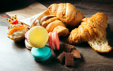 French pastries, desserts: croissants, macaroons, cake, chocolate