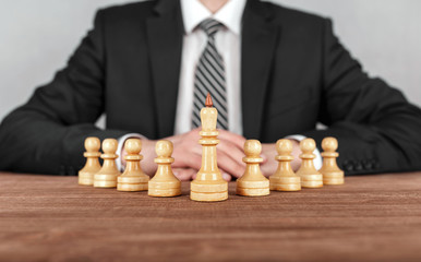 Businessman is sitting in front of chess . Concept of business strategy.