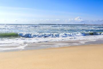 Beautiful ocean waves on the sand beach.